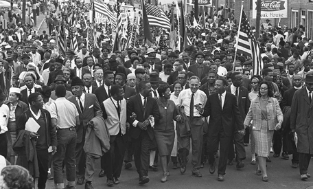 Martin Luther King, Jr. leads marchers across the Alabama River on the first day of the Selma-to-Montgomery march.
