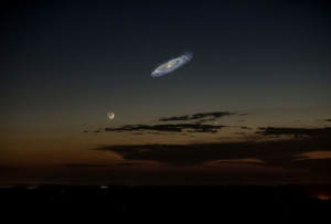 If the whole galaxy were bright enough, this is what you'd see at night (with the moon as a reference).