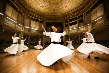 Whirling dervishes perform at the Galata Mevlevihane (The Lodge of the Dervishes) in Istanbul. The dervishes are adepts of Sufism, a mystical form of Islam that preaches tolerance and a search for understanding. Those who whirl, like planets around the sun, turn dance into a form of prayer.  (Gurcan Ozturk/Getty Images)