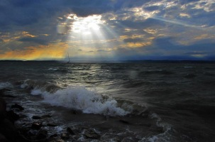 sun-shining-through-clouds-on-the-water1